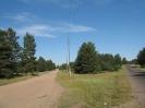 Первый поворот Ямаровского тракта. Слева старая дорога. Справа шоссе перед знаком