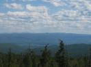 Вид на гольцы Маслакан, Мергенский, Ясытай и падь Ямаровка. Справа вдали отроги Быстринского гольца (2519 м)