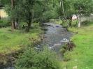 Речка Ямаровка. Вдали справа здание, перед которым минеральный источник